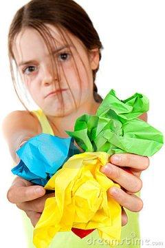 grumpy-girl-holding-crumpled-paper-balls-thumb17074103
